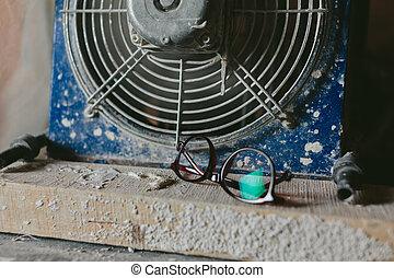 designer glasses lie near the fan