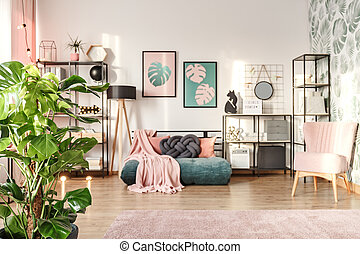 Designer interior with emerald settee - Big monstera plant...