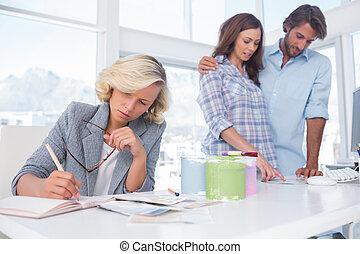 Designer is working in her bright office