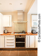 Designer kitchen - Modern white kitchen with wooden worktops...