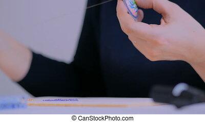 Designer making handmade brooch - Close up shot -...