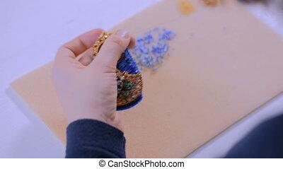 Designer making handmade brooch - Professional jewelry...