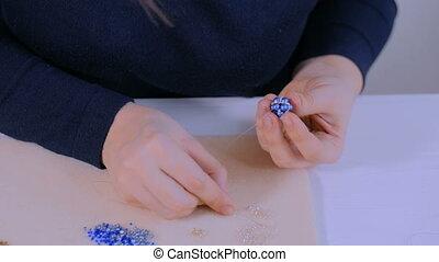 Designer making handmade eardrop - Professional jewelry...