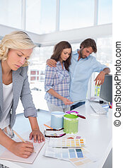 Designer making plan in her bright office