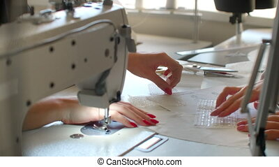 designer of clothes makes an outline of clothes with a felt-tip pen. female hands close up.