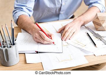 Designer of timber industry working on original drawing in workshop
