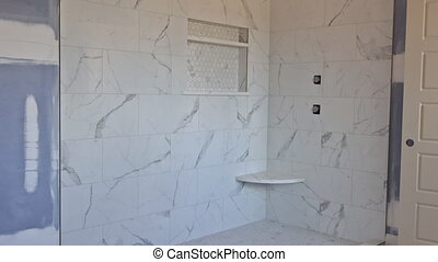 Designer renovation construction bathroom with interior of master bathroom patching drywall