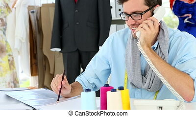 Designer talking on the phone