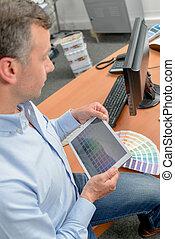 Designer using a tablet