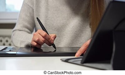 Designer using graphic tablet at home. - Female designer ...