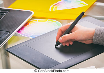 Designer using graphics tablet