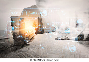 designer using smart phone and keyboard dock digital tablet. Worldwide network connection technology interface. on marble desk, sun flare effect