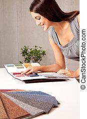 Designer with Carpet Samples - A female interior designer...