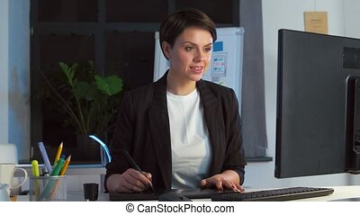 designer with computer and pen tablet at office - business,...