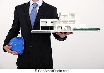 Designer with model house