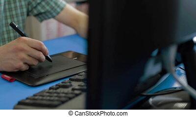 Designer working with digital Drawing tablet - Male designer...