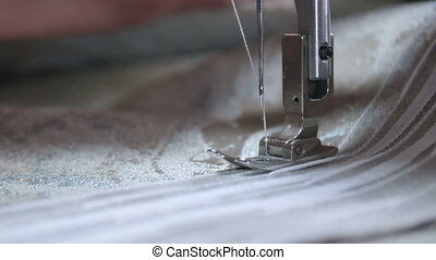 Designer working with sewing machine. Close up. Slow motion....