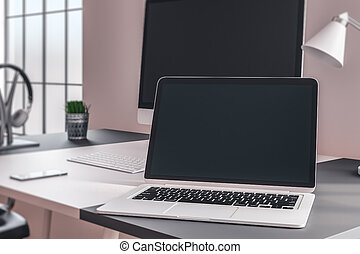 Designer workplace with laptop