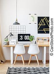 Designer workspace with black painting