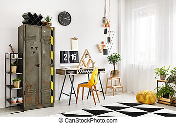 Designer workspace with industrial shelf