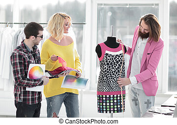 designers discussing new fabric patterns in a creative Studio