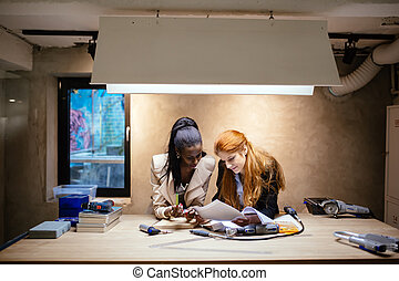 Designers working in modern office