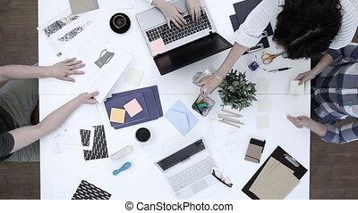 Designers working in studio - Video of fashion designers...