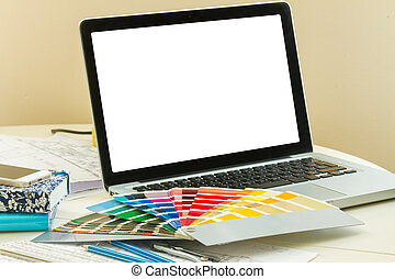 designer's working table - open notebook with colour charts