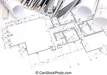 designers workplace with drawing tools and floor plan