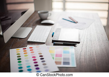 Designer's workspace with bokeh