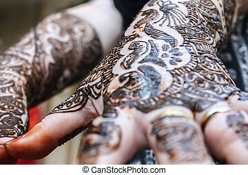 designing heena is on both hands - designing henna is...