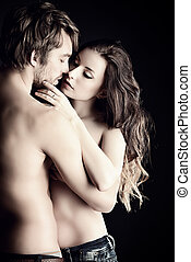 desire - Beautiful passionate naked couple in love. Over...