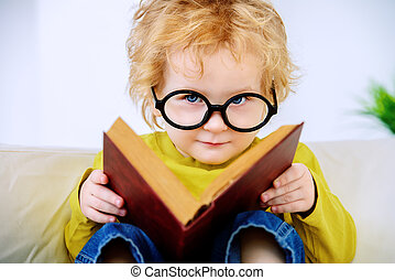 desire for knowledge - Small three year old boy in glasses ...