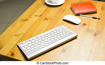 Desk accessories desktop, keyboard, computer mouse on wooden oak table