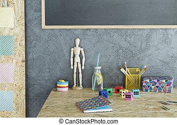 Desk against grey wall