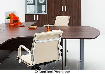 desk and armchair on white wall