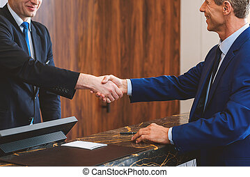 Desk clerk and client in expensive hotel