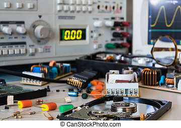 desk in electronic laboratories, faulty HDD and power supplies between different spare parts