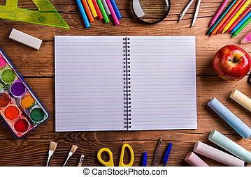 Desk, school supplies, lined paper, wooden background - Desk...