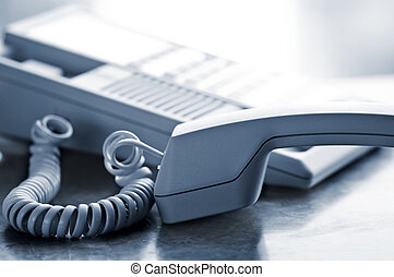 Desk telephone off hook - Telephone handset off the hook on...