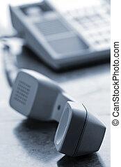 Desk telephone off hook - Telephone handset off the hook on...