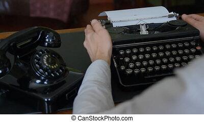 Desk. Vintage typewriter, old phone