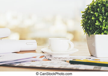 Desk with coffee and plant - Closeup of desk with coffee...