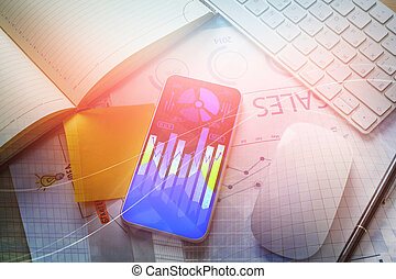Desk with forex chart on phone