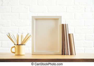 Desk with image frame and supplies