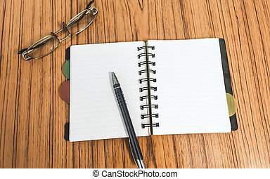Desk with open notebook with blank pages, eye glasses and a pen. Top view with copy space. Business still life concept with office stuff on table. Education, working, planning concept. Top View.