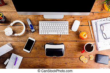 Desk with various gadgets and office supplies. Flat lay -...