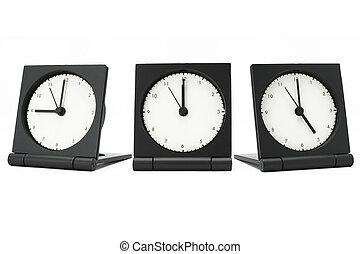 Desktop alarm clocks showing 9 am to 5 pm on white background