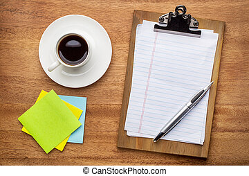 desktop concept - clipboard, sticky notes and coffee