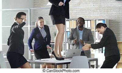 Desktop Dance - Multinational business team of five...